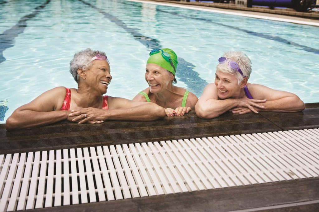 3 women swimming in the pool